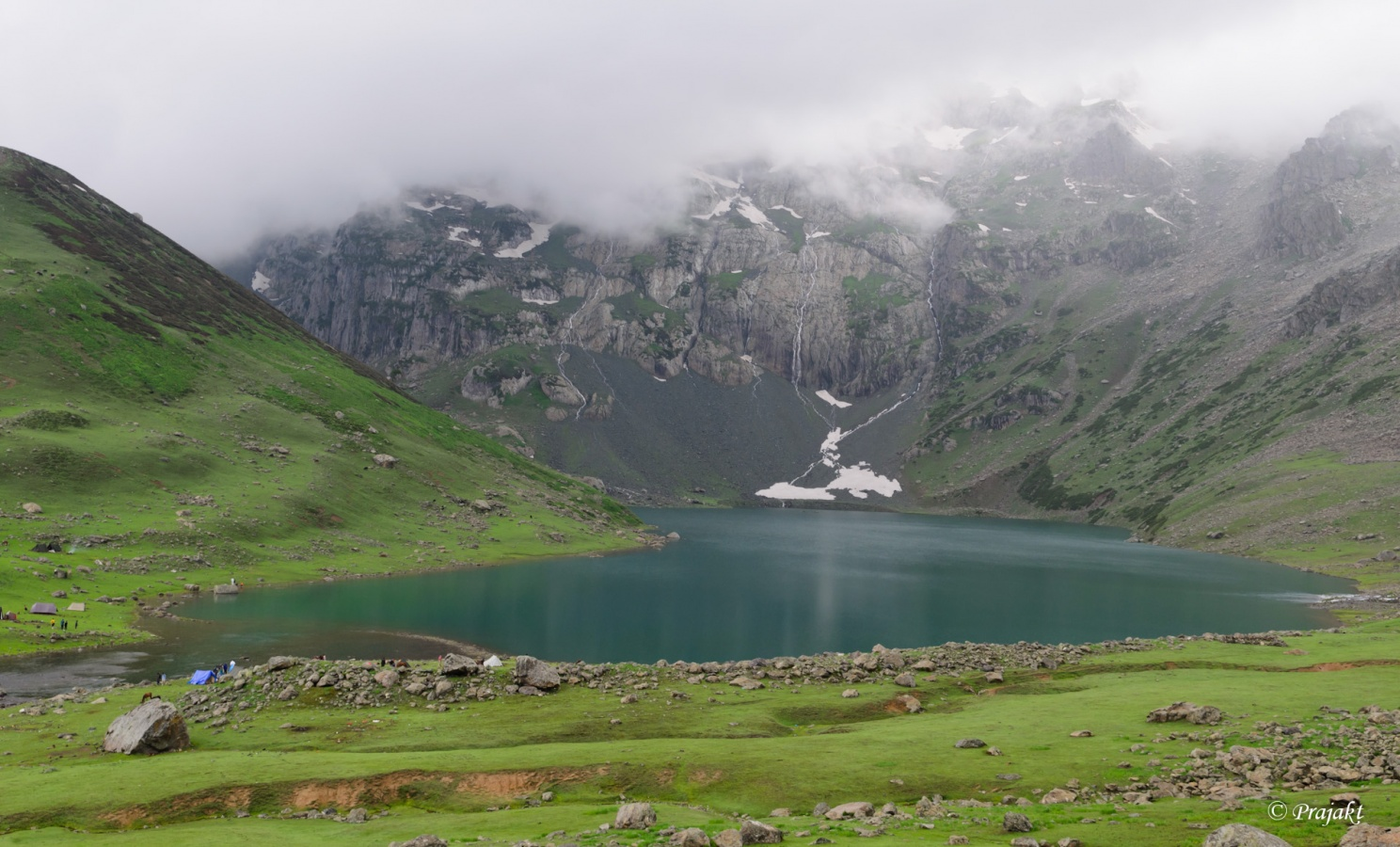 First view of small Gangabal lake and Harmukh peak in rain.jpg